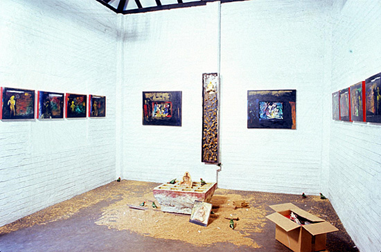 "Jagath Weerasinghe: ""Yantra Gala"" And The Round Pilgrimage 1999. Installation in the Heritage Gallery comprising eight oil paintings on canvas with collage, elements of an altar with wood, resin, clay, gold leaf, wheat, earth."