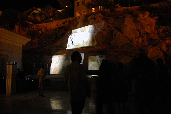 Fragments of the Unseen by Medea Electronique, projected on the rocks of the Historical Archives Museum Hydra, 2011.