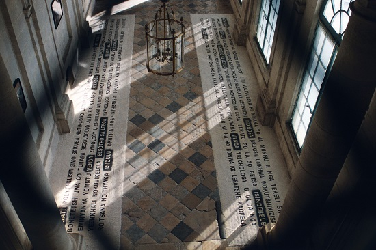 Willem Boshoff Writing in the Sand (2001) Ten 40kg bags of black and white sand, stencils, sieve, and buckets used for a floor installation. The Castle Champlitte, France (2001). Photo: Katja Gentric, courtesy of the artist