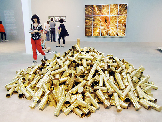 "The group exhibition ""Untitled (Death by Gun)"" In the forground: Kris Martin - ""Obussen II"" (700 Howitzer shells from WWWI) In the background: Matt Collishaw - ""Bullet Hole"". Photo Seismopolite."